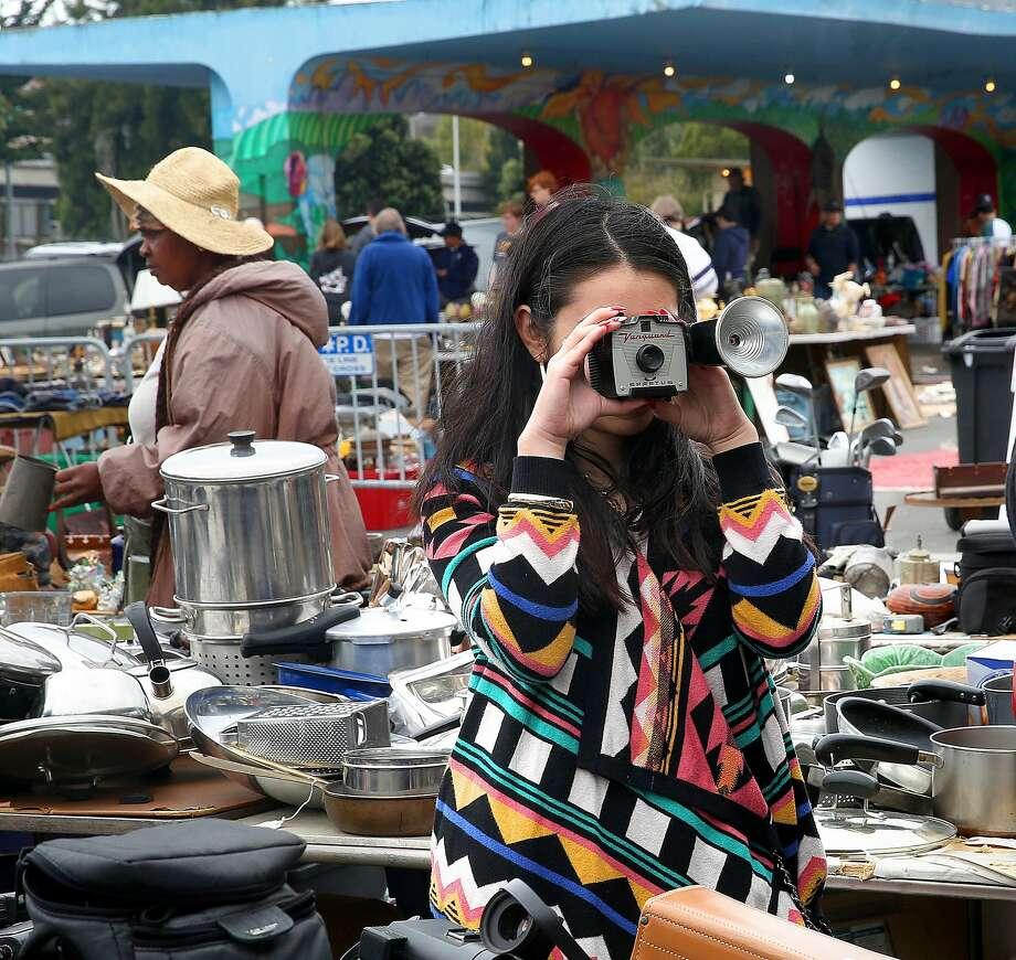 Cameras next to kitchen ware at the Alemany Flea Market. Photo: Liz Hafalia, The Chronicle