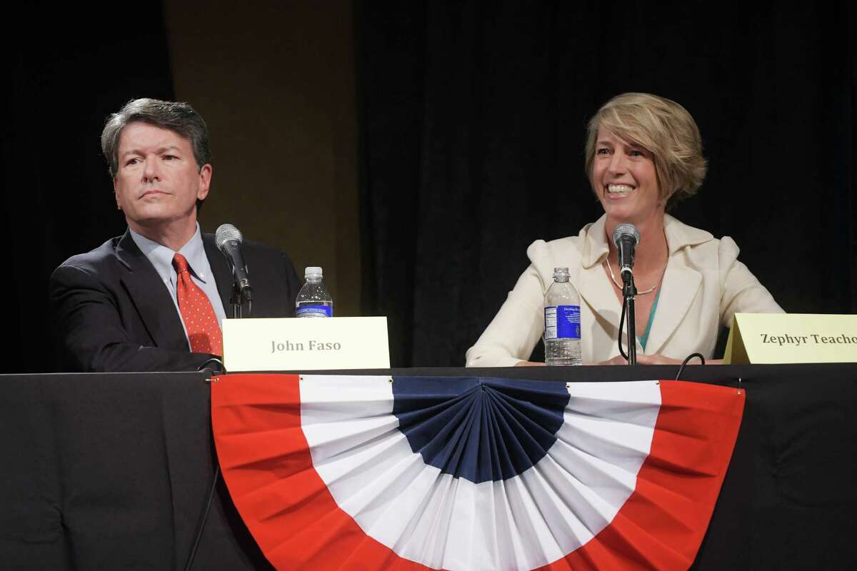 Republican John Faso, left, and Democrat Zephyr Teachout, right, take part in a debate at WAMC's Performing Arts Center on Thursday, Sept. 15, 2016, in Albany, N.Y. (Paul Buckowski / Times Union)