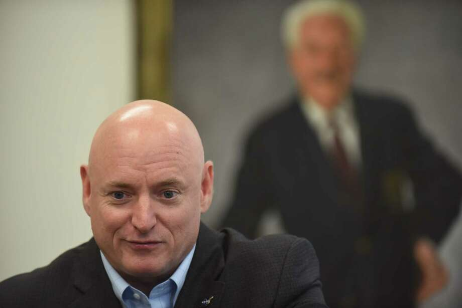 Retired astronaut Scott Kelly speaks during a press conference at Trinity University on Thursday, Sept. 14, 2016. Kelly spent over one year on the International Space Station. A portrait of music educator Albert Herff-Béze hangs on the wall behind him. Photo: Billy Calzada, Staff / San Antonio Express-News / San Antonio Express-News