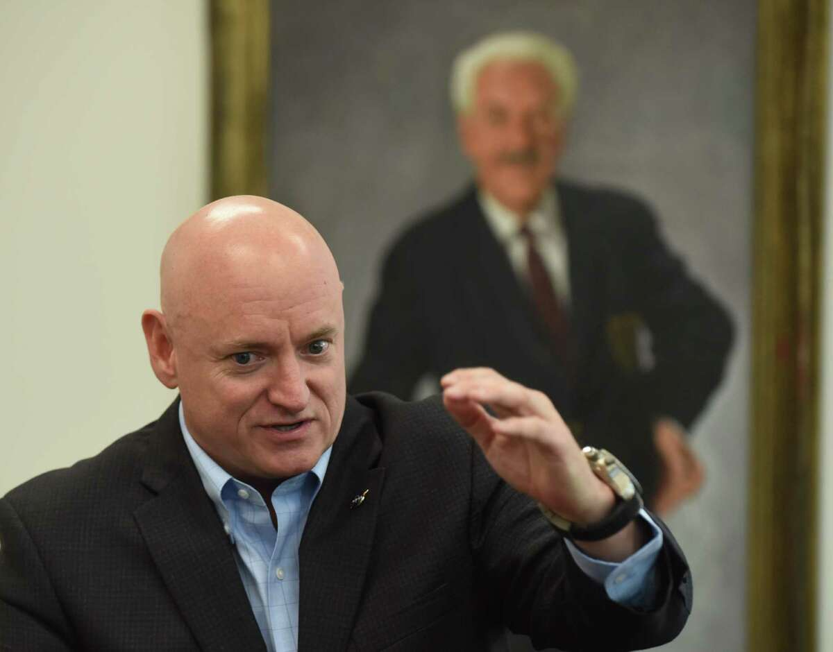 Retired astronaut Scott Kelly speaks during a press conference at Trinity University on Thursday, Sept. 14, 2016. Kelly spent over one year on the International Space Station. A portrait of music educator Albert Herff-Béze hangs on the wall behind him.
