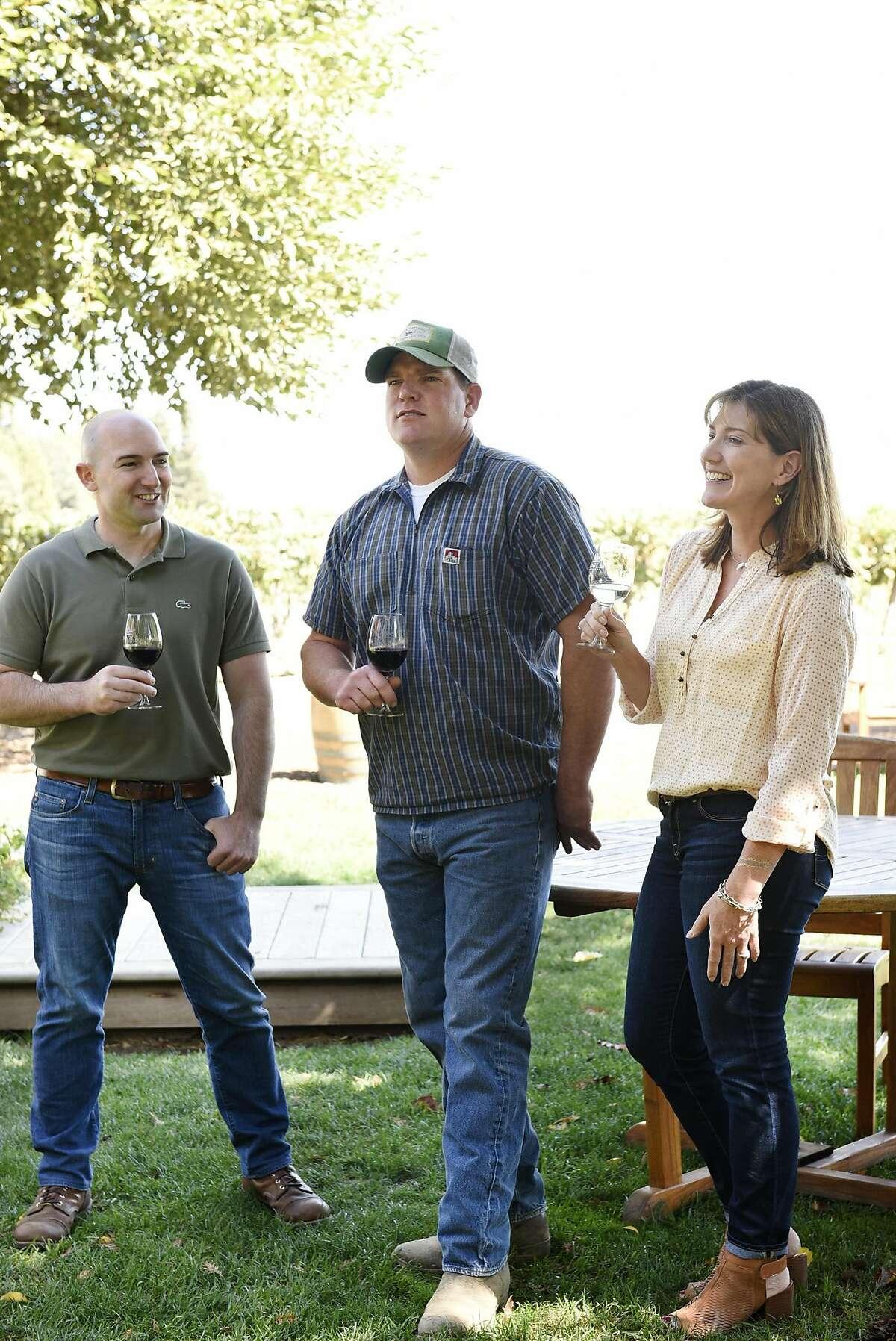 Ryan Bogle, left, Warren Bogle, and Jody Bogle pose for a portrait at Bogle Winery in Clarksburg, CA Wednesday, September 14, 2016.