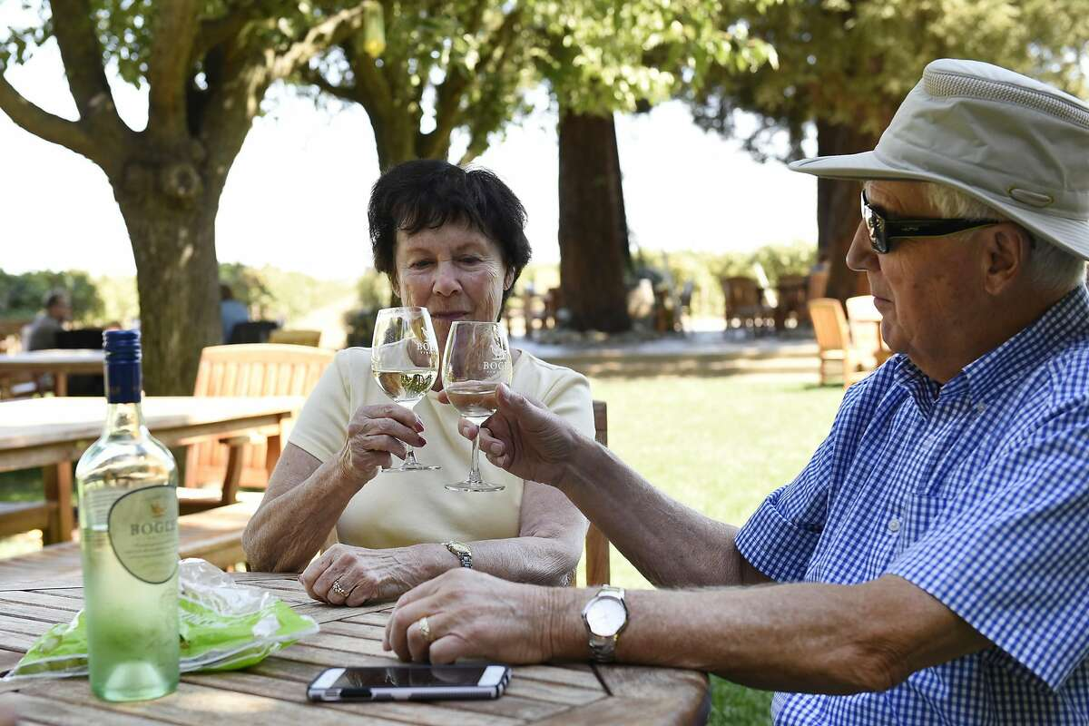 Regular visitors Shirley and Dennis Kerton of West Sacramento enjoy a bottle of 2014 Sauvignon Blanc with lunch in the yard at Bogle Winery in Clarksburg, CA Wednesday, September 14, 2016.