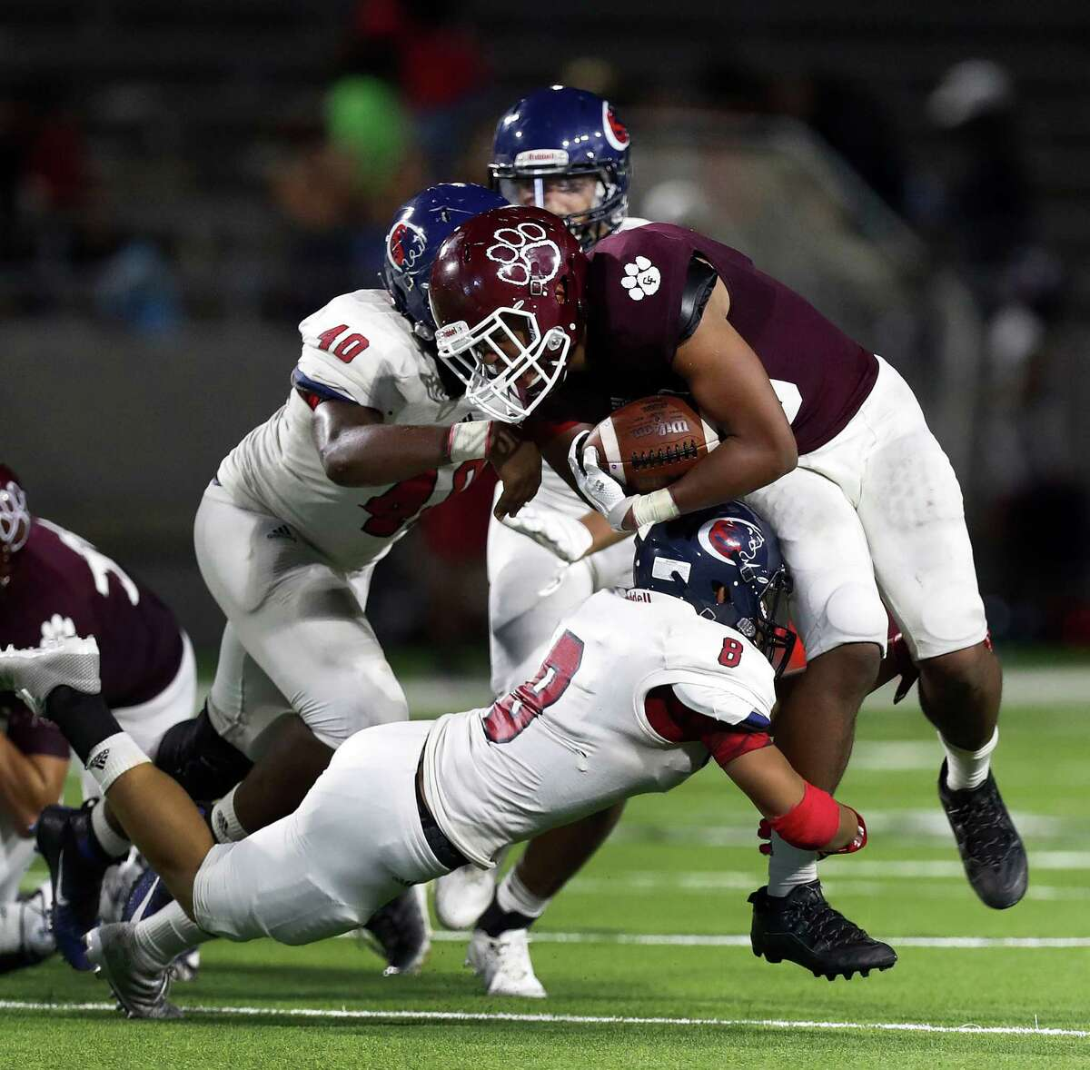 Cy-Fair's Trenton Kennedy (43) is tackled by Cypress Spring' Jonathan Huynh (8) during the second half of the Cy Springs vs. Cy-Fair high school football game at Pridgeon Stadium, Thursday, Sept. 15, 2016 in Houston.