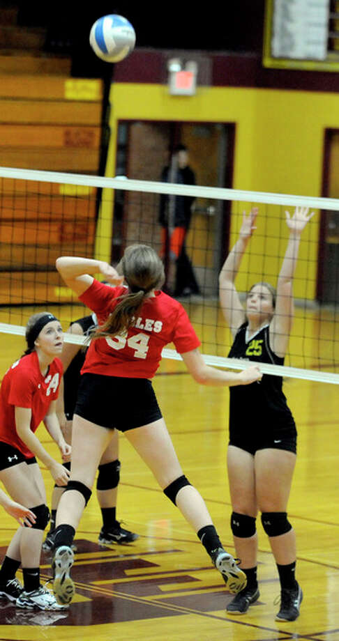Caseville's Olivia Grates (34) attempts a kill in Set 2.