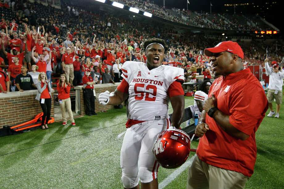PHOTOS: UH vs. SMU CINCINNATI, OH - SEPTEMBER 15: Jerard Carter #52 of the Houston Cougars celebrates along with fans after an interception return for a touchdown by Howard Wilson in the fourth quarter against the Cincinnati Bearcats at Nippert Stadium on September 15, 2016 in Cincinnati, Ohio. Houston defeated Cincinnati 40-16. >>>See the Cougars in action during last week's game against SMU ... Photo: Joe Robbins, Getty Images / 2016 Getty Images