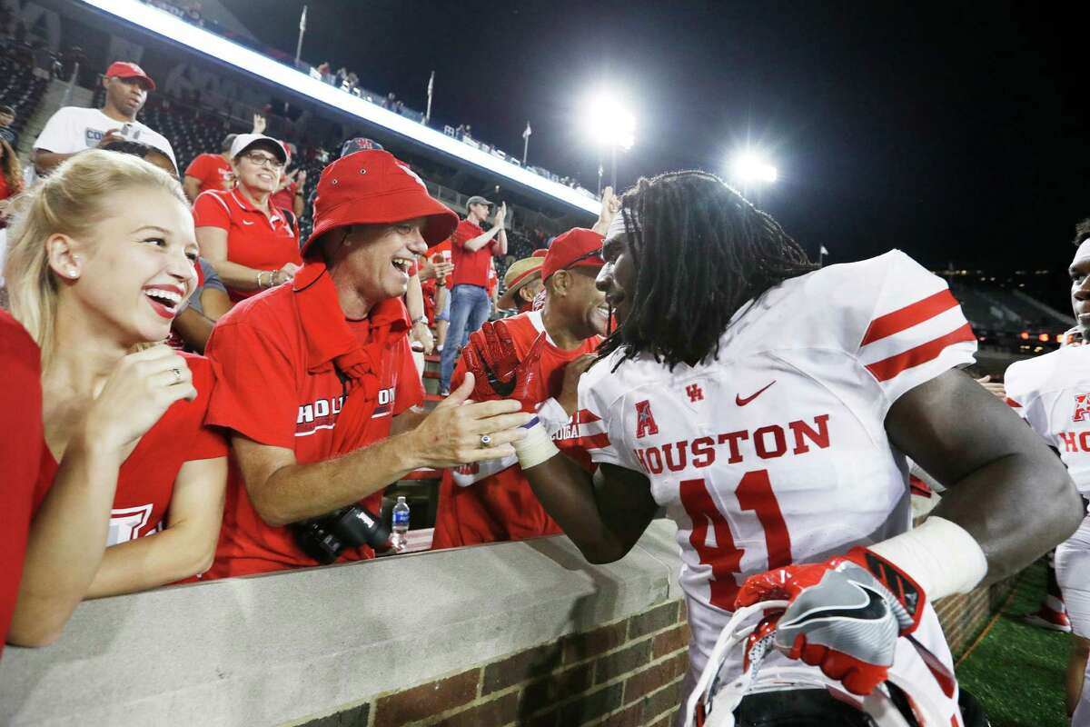 CINCINNATI, OH - SEPTEMBER 15: Steven Taylor #41 of the Houston Cougars celebrates with fans after the game against the Cincinnati Bearcats at Nippert Stadium on September 15, 2016 in Cincinnati, Ohio. Houston defeated Cincinnati 40-16.