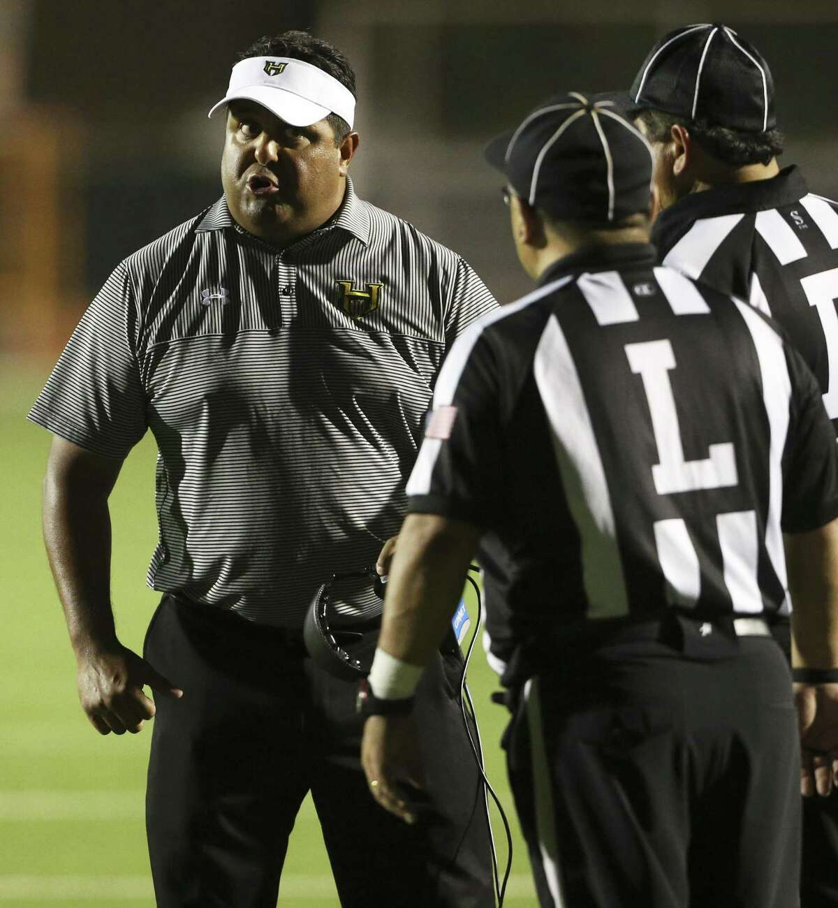 Husky coach Eddie Salas talks with refs as Holmes hosts Harlandale in 2016. Harlan and Holmes play Saturday.