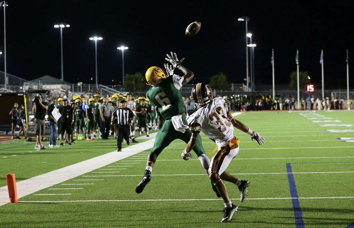 Husky receiver Quentrevious hauls in a touchdown catch against Isaac Barrera in the second quarter as Holmes hosts Harlandale at Gustafson Stadium on September 15, 2016.