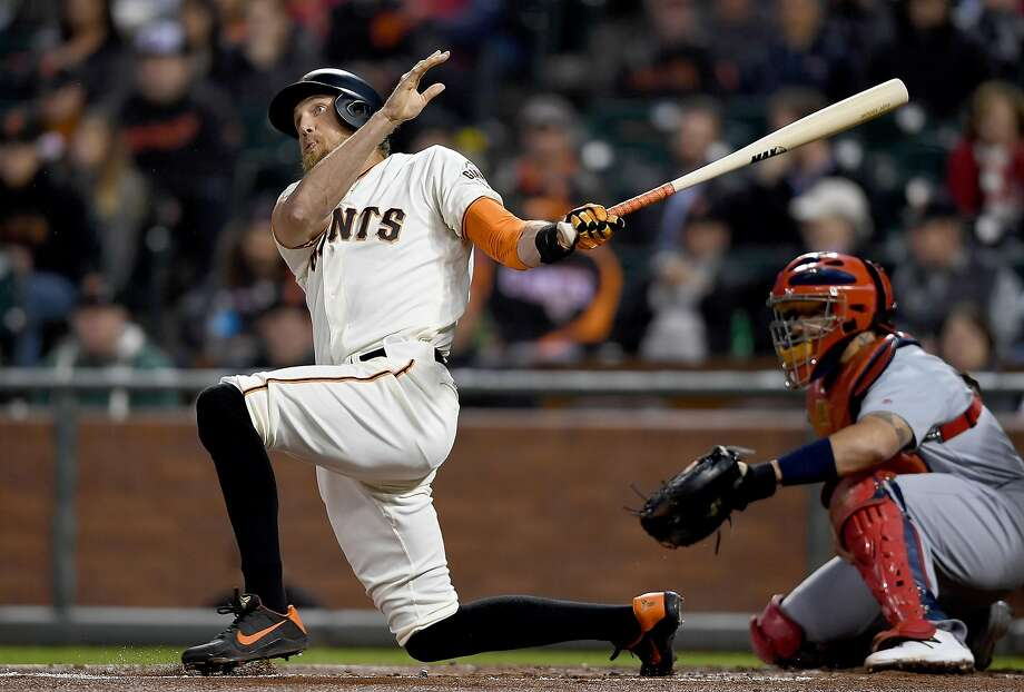 Hunter Pence's follow-through on his two-run, first-inning homer dropped him to a knee. Photo: Thearon W. Henderson, Getty Images