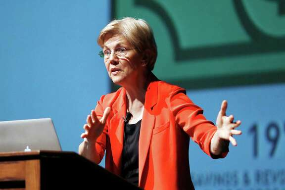 Sen. Elizabeth Warren gives a presentation on the American economy and the middle class to a packed auditorium and additional overflow room at Berkshire Community College in Pittsfield, Mass., Saturday, Aug. 27, 2016. (Stephanie Zollshan /The Berkshire Eagle via AP)