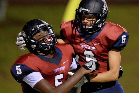 Alex Tchouangwa (5) celebrates a Tompkins touchdown with Dylan Gerald (6) in the fourth quarter of a high school football game between the Tompkins Falcons and Houston Heights Bulldogs on September 15, 2016 at Rhodes Stadium, Katy, TX.