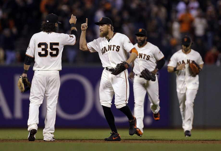 Brandon Crawford (left) and Hunter Pence celebrate after the Giants beat the Cardinals. Photo: Ben Margot, Associated Press