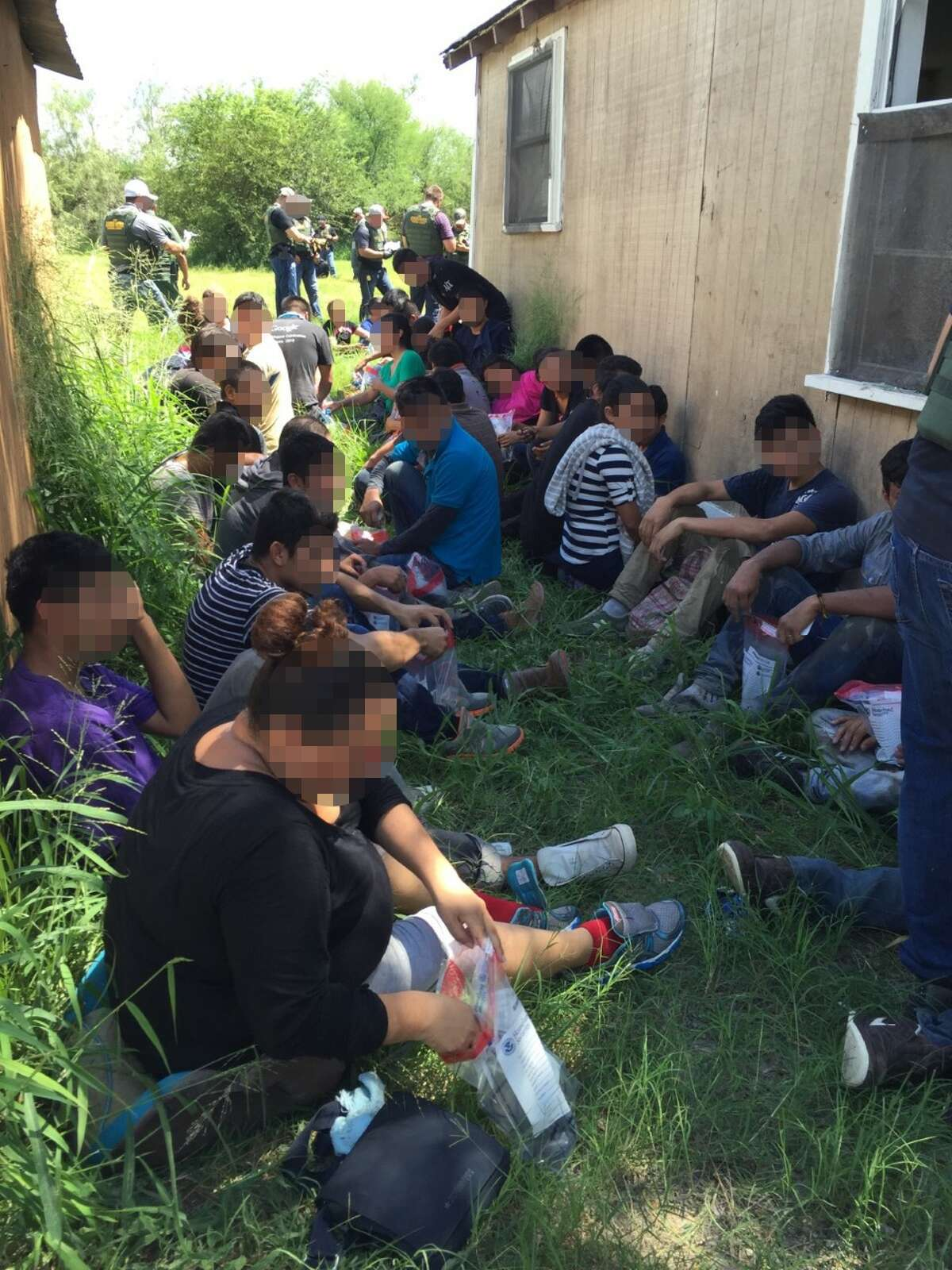 Law enforcement officials apprehended 57 undocumented immigrants from a stash house in Edinburg, Texas, where five were arrested on Sept. 14, 2016.