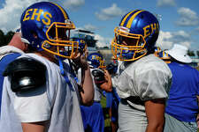 New Evadale wide receiver Kolten Mackey, right, talks with teammates during practice on Sept. 14.