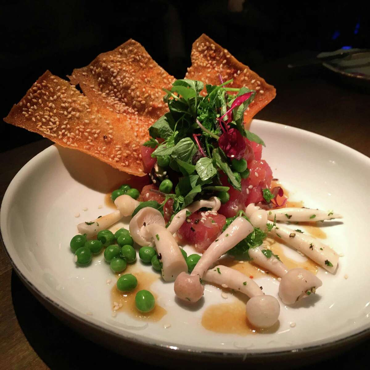 Tuna poke with Korean lemon tea and soy dressing, pickled enoki, spring peas and anise greens at Brasserie 1895