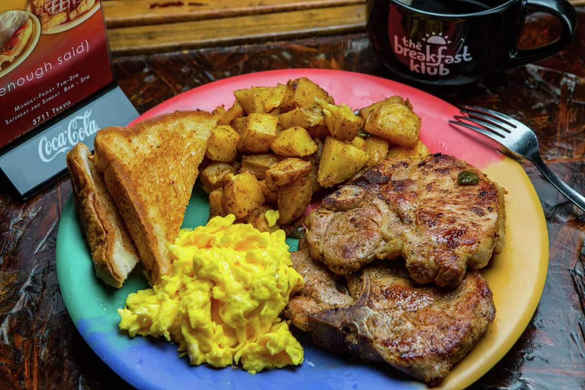 Grilled pork chops with scrambled eggs, potatoes and Texas toast at The Breakfast Klub