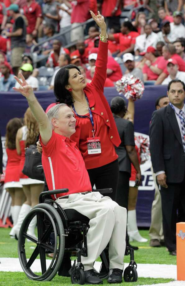 Texas Gov. Greg Abbott, seen here with UH president Renu Khator before the Cougars' Sept. 3 season opener at NRG Stadium, sounded off on the Big 12's decision not to expand. Photo: Elizabeth Conley, Houston Chronicle / © 2016 Houston Chronicle
