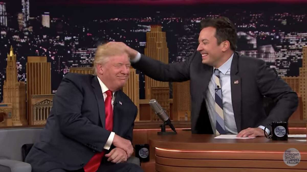 """""""Tonight Show"""" host Jimmy Fallon tussles Donald Trump's highly controversial hair on Sept. 15, 2016."""