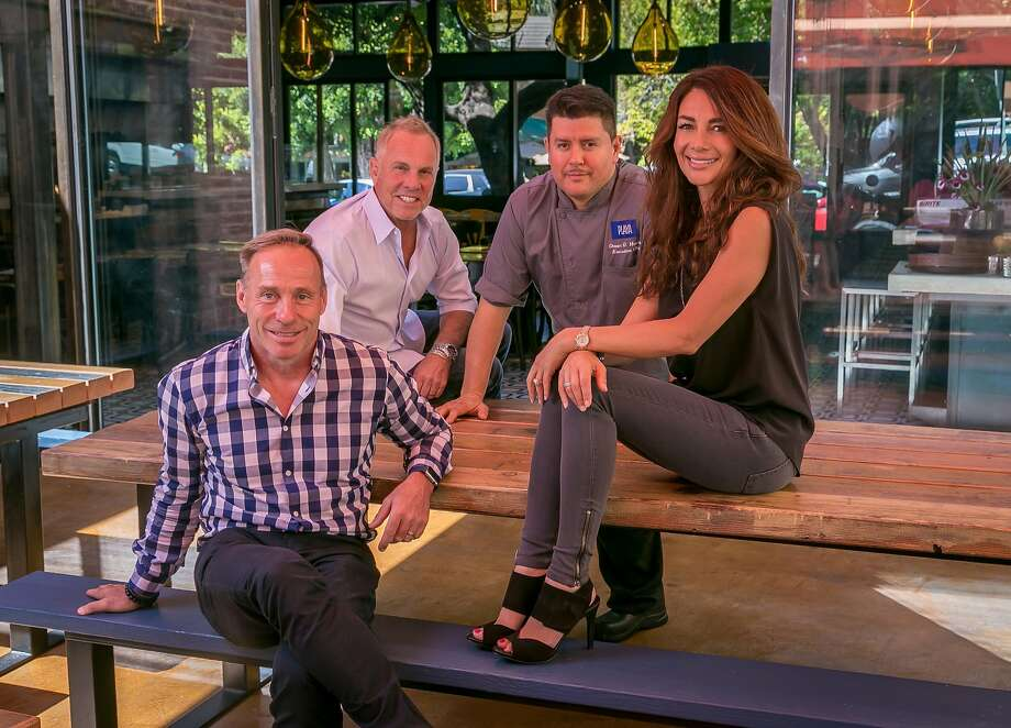 Playa owners Peter Schumacher (left), Bill Higgins, chef Omar Huerta and owner Vanessa Higgins at Playa in Mill Valley. Photo: John Storey, Special To The Chronicle