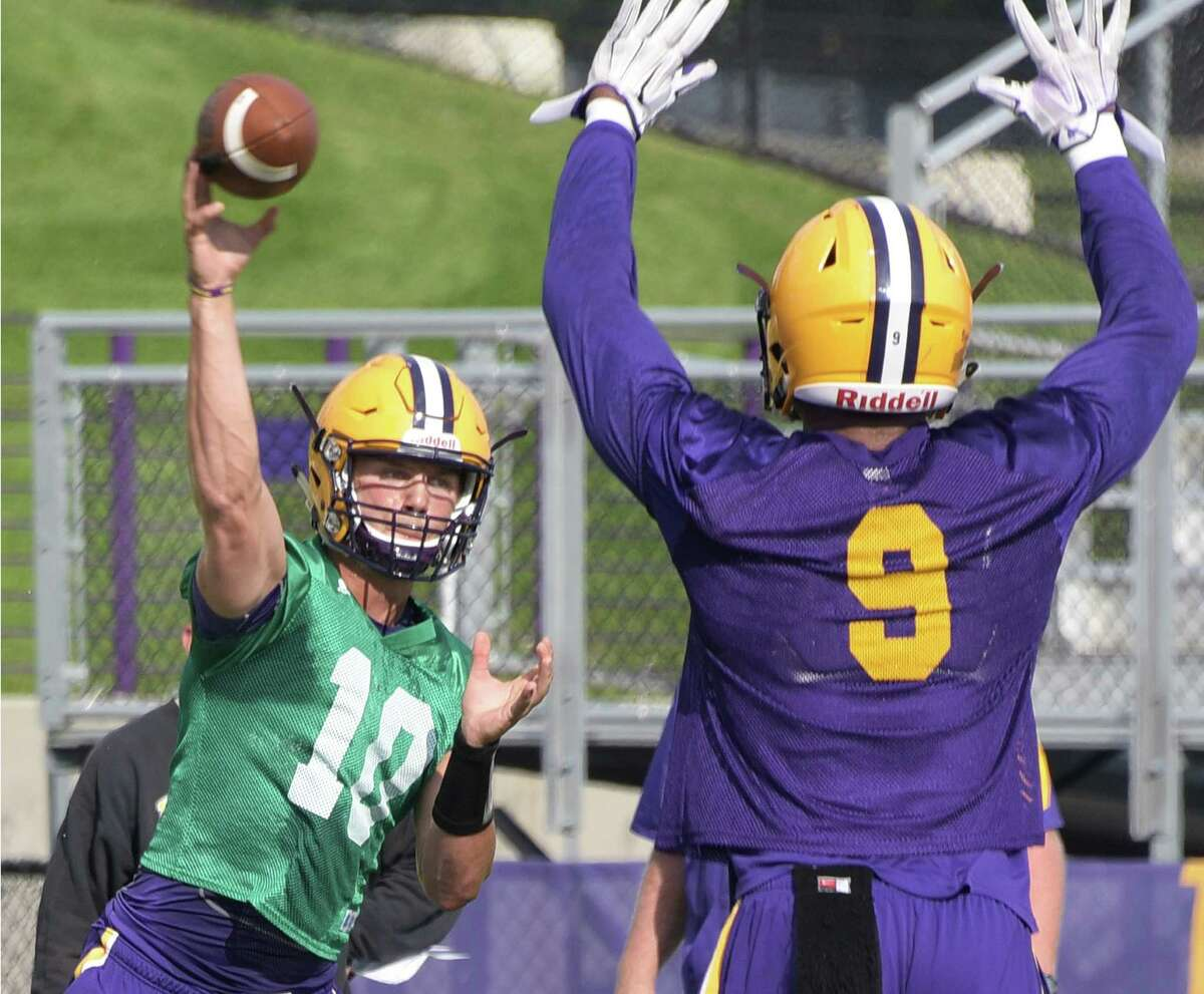 UAlbany football quarterback Neven Sussman, left, is pressured by defensive lineman Malachi Hoskins, right, during practice at Casey Stadium Saturday Aug. 13, 2016 in Albany, NY. (John Carl D'Annibale / Times Union)