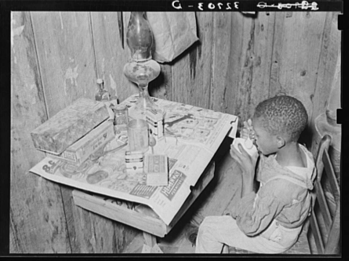 """Flour and water passed as """"milk."""" Original description: """"Boy drinking 'milk' made of flour and water. He was sick and his mother, the wife of a sharecropper, had given him this as a delicacy."""" Date: March 1939."""