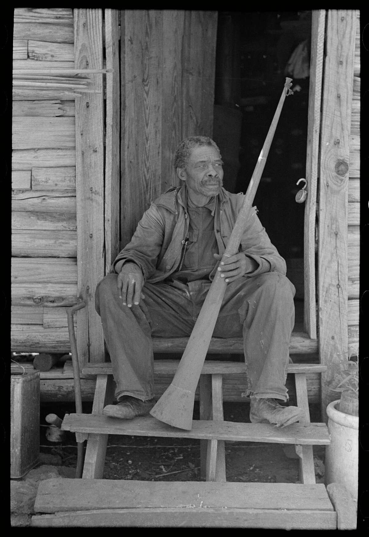 """Former slaves were still alive Original description: """"Old Negro (former slave) with horn with which slaves were called."""" Date: April 1939."""