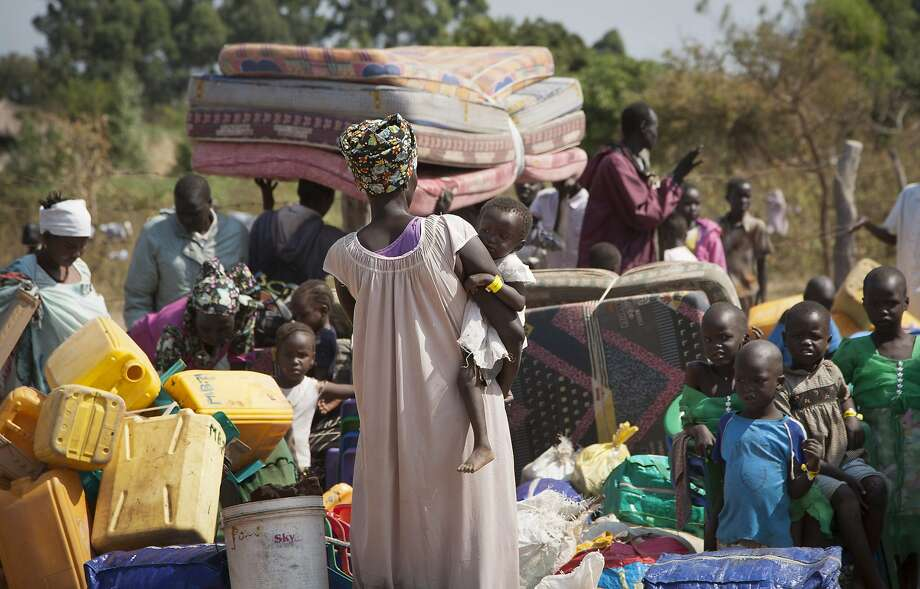 Refugees fleeing violence in 2014 crossed the border into Uganda with whatever they could carry. Photo: Rebecca Vassie, Associated Press