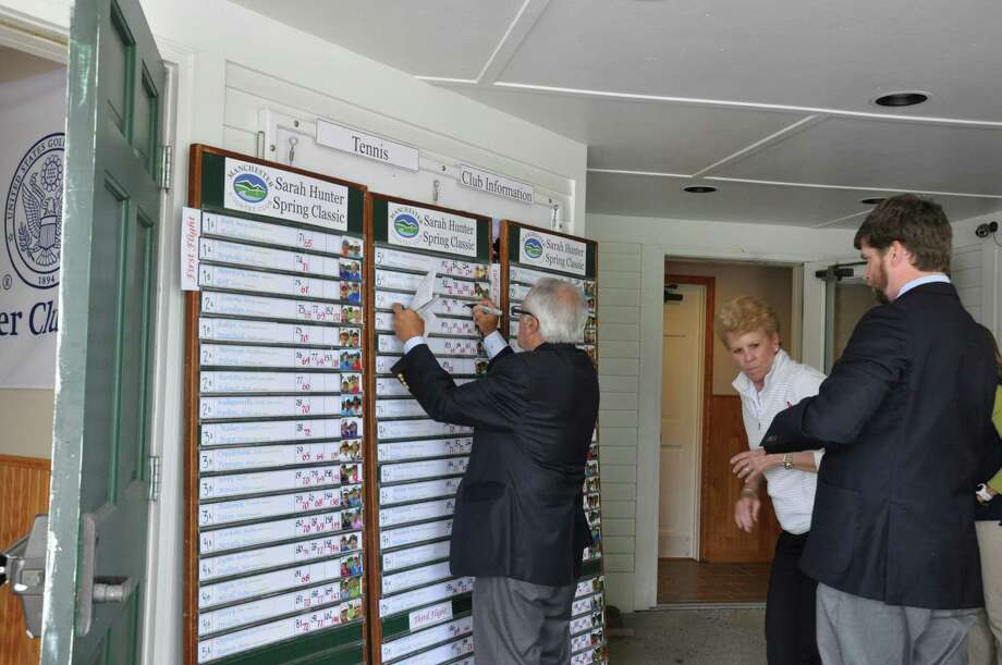 Manchester Head Golf Professional Michael Harger, right, tournament chair Barbara Price, and Fred Auletta, PGA Teaching Professional,  complete the scoreboard after the final day of competition at the Sarah Hunter Spring Classic on  May 22, 2016 in Manchester, Vermont. (Joyce Bassett / Times Union)