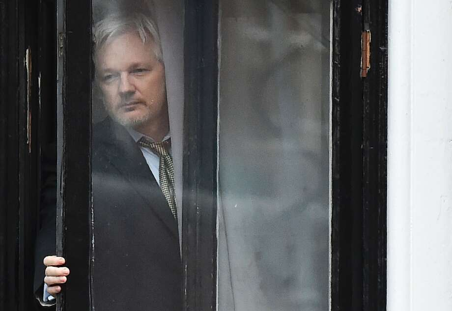 The WikiLeaks founder addresses reporters on the balcony of the Ecuadoran Embassy in London. Photo: BEN STANSALL, AFP/Getty Images