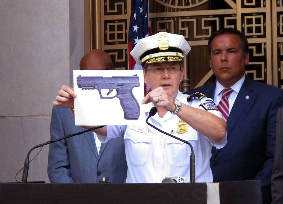 Police Chief Kim Jacobs shows the type of BB gun that officers say 13-year-old Tyre King pulled from his waistband just before he was fatally shot by police in Columbus, Ohio. Photo: Andrew Welsh-Huggins, Associated Press