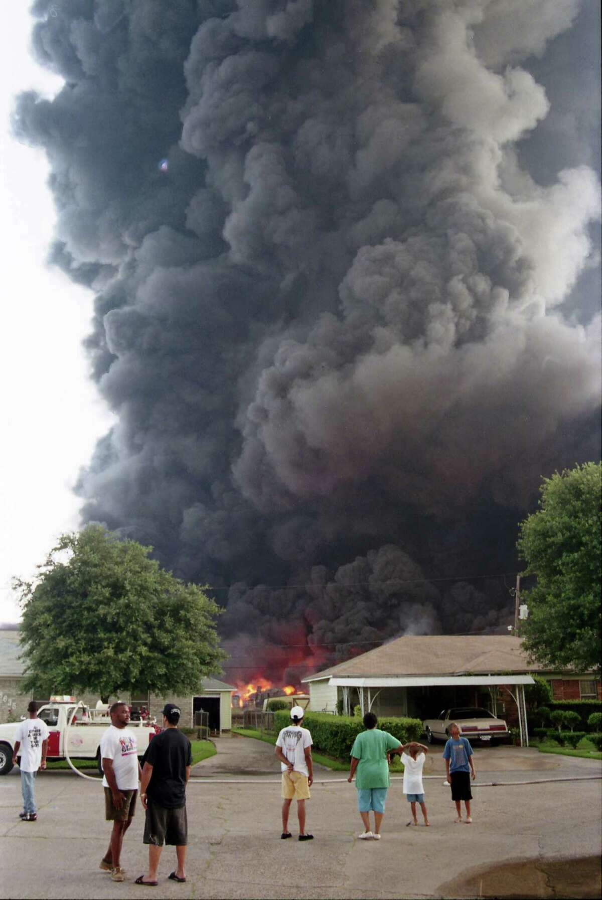 Thick, black smoke reached into the sky as the fire gutted the warehouse complex.
