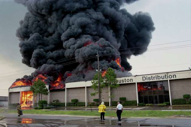 06/24/1995 - About two-thirds of the city's on-duty firefighters were sent to battle a seven-alarm fire which broke out just before 9 a.m. at the Houston Distribution Inc. warehouse at 8500 Market. Thick, black smoke poured thousands of feet into the sky as the warehouse fire gutted the complex and forced voluntary evacuations in the Pleasantville area but spared firefighters and residents serious injury. Photo: Howard Castleberry, © Houston Chronicle / Houston Chronicle