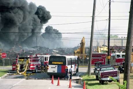 07/23/1995 - Smoke rises from the rubble left by two earlier fires at Houston Distribution Inc. For the third time in four weeks, fire erupted at the warehouse complex, sending clouds of dark gray smoke wafting once again over east Houston near Pleasantville. Firefighters extinguished the fire less than an hour after it was reported at 5:22 p.m. Sunday.