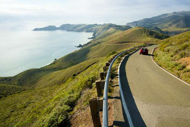 A car descends Conzelman Road in the Marin Headlands north of San Francisco, California.