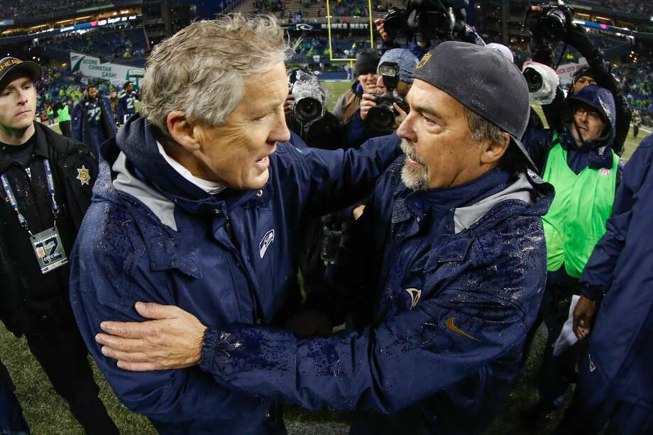 Head coach Jeff Fisher of the St. Louis Rams is congratulated by head coach Pete Carroll of the Seattle Seahawks after the Rams defeated the Seahawks 23-17 at CenturyLink Field on December 27, 2015 in Seattle, Washington.  (Photo by Otto Greule Jr/Getty Images) Photo: Otto Greule Jr/Getty Images