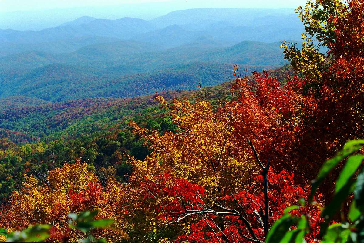 Autumn colors in the Blue Ridge Mountains, like these near Linville, N.C., Monday, Oct. 14, 1996, reach their peak this week. Scenic overlooks on the Blue Ridge Parkway allow travelers to view the brilliant foliage. (AP Photo/The Daily News, Don Bryan)