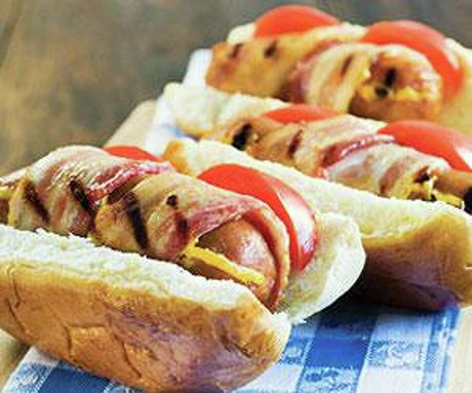 Houston-based Holmes Smokehouse is donating hot dogs to a variety of local non-profit organizations throughout the current Houston Texans football season. The first donation of 2,349 hot dogs was made to Heavenly Hands at Bethel's Place Empowerment Center on Sept. 16. The number of hot dogs donated to charity is based on the number of Holmes Smokehouse foot-long hot dogs sold at each home game. The hot dogs will be donated after each home game to different area charities. After teaming with the Houston Texans in August, Holmes created a line of gourmet hot dogs and Texas beef chili available at NRG Stadium (and to be introduced to the marketplace). The line includes Original, All Beef, Beef with Jalapenos, Beef with Cheddar, and Beef blended with Smoked Brisket. Photo: Holmes Smokehouse