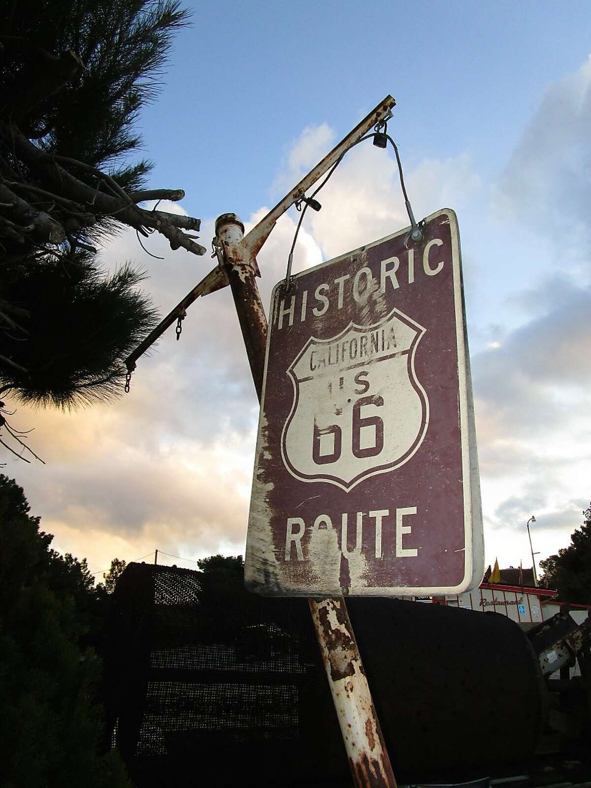 This undated photo provided by the American Indian Alaska Native Tourism Association shows the Route 66 sign near the historic Summit Inn at the end of Cajon Pass in California. The association is releasing a guidebook that details more than two dozen tribal communities along America's Mother Road. (Lisa Snell/American Indian Alaska Native Tourism Association via AP)