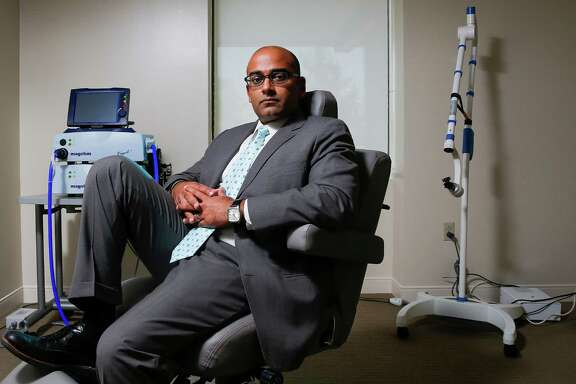 Menninger Clinic pain management program director and McNair scholar Alok Madan sits for a portrait in his office Friday, September 2, 2016 in Houston.