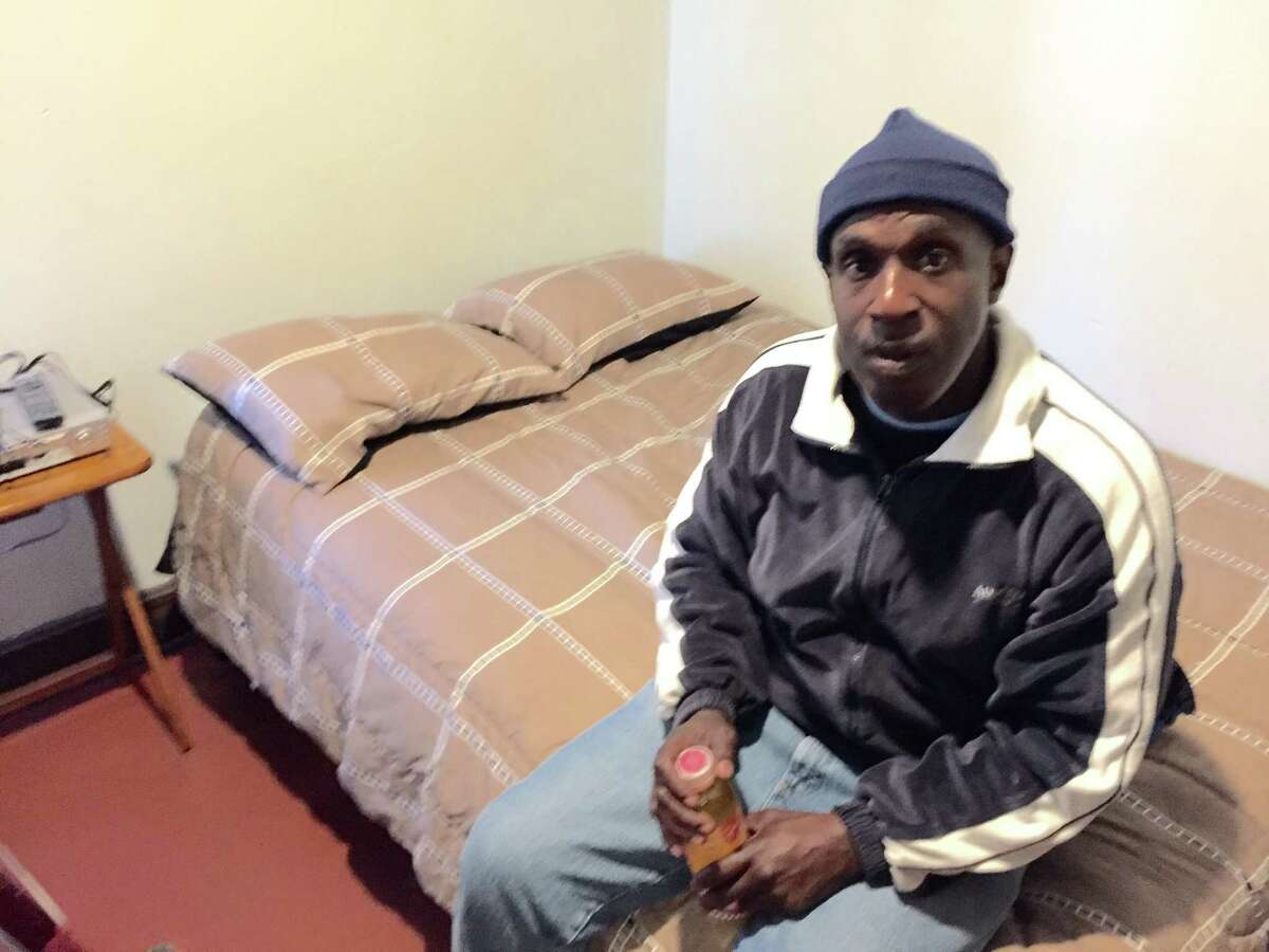 Thomas Smith, 52, of Albany, an ex-convict who was formerly homeless, was fired from his $9-an-hour job gathering shopping carts at the Wal-Mart Supercenter in East Greenbush after he redeemed $5.10 worth of empty cans and bottles discarded in the parking lot. He is shown here in his room at an Albany rooming house where his rent is paid for by Homeless and Travelers Aid Society. (Paul Grondahl / Times Union)
