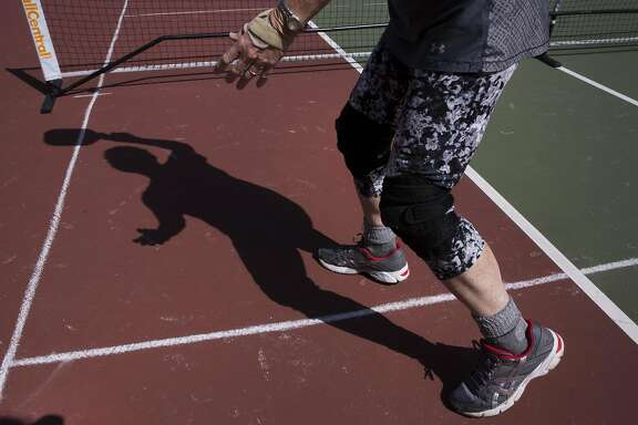 Carolyn Harvey, 70, leads a pickleball game at the Golden Gate Park Tennis Courts on Wednesday, September 14, 2016 in San Francisco, Calif. Pickleball is a racquet sport that combines elements of tennis, ping pong and badminton. Harvey started groups playing several times a week at the tennis courts after retiring and learning the sport two years ago.
