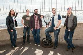 NEW YORK, NY - SEPTEMBER 25:  (L-R) Tim Foust, Austin Brown, Rob Lundquist, Chris Rupp and Adam Rupp of the band 'Home Free', season 4 winners of NBC's The Sing-Off visit The Empire State Building at The Empire State Building on September 25, 2015 in New York City.  (Photo by Noam Galai/WireImage)