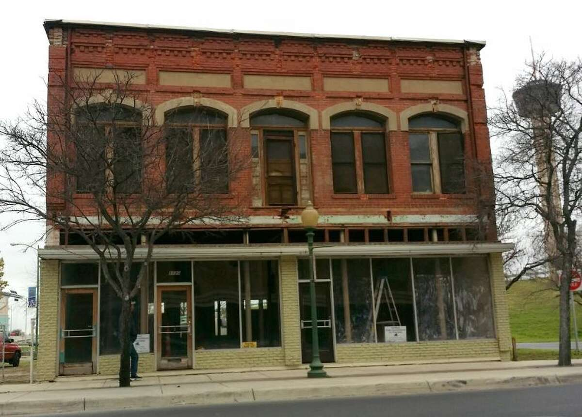 The owner of a two-story historic building at the entrance of St. Paul Square plans to rehabilitate it as apartments and retail.
