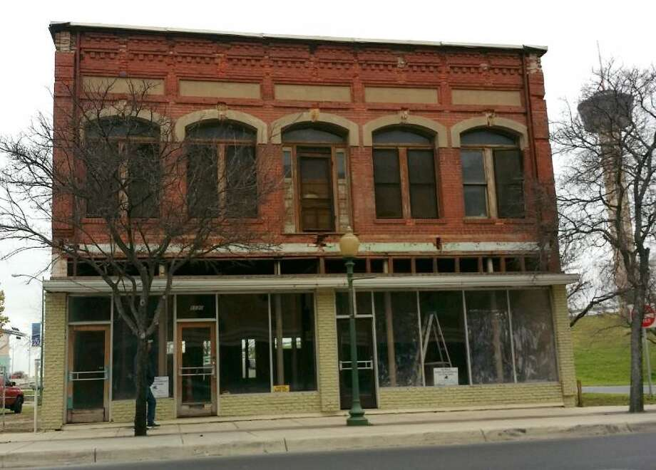 The owner of a two-story historic building at the entrance of St. Paul Square plans to rehabilitate it as apartments and retail. Photo: Courtesy, Historic And Design Review Commission