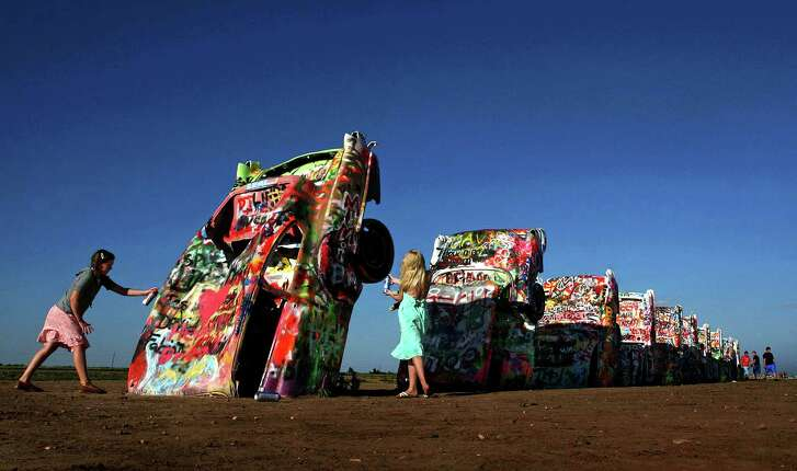 It's OK to add one's own artistic mark at the famed Cadillac Ranch in Amarillo.