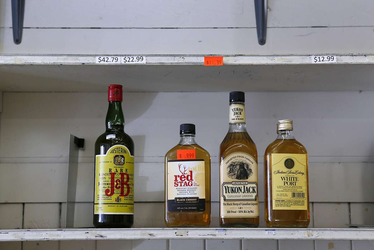 A little bit of booze is all that remains on the shelf as Hanna Chedyak packs up what's left from his Fog Hill Market at Kearny and Green streets in San Francisco, Calif. on Friday, Sept. 16, 2016. Chedyak is being evicted by his landlord after owning the corner store on Telegraph Hill for over 20 years.