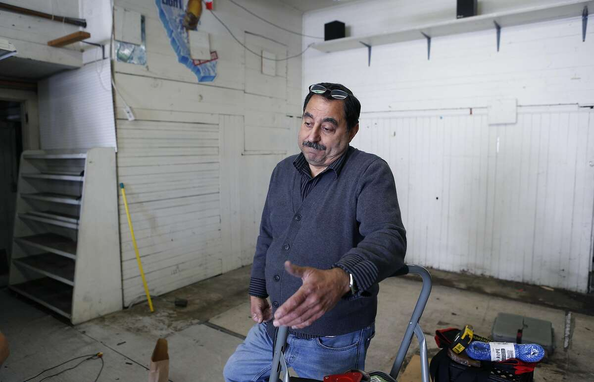 Hanna Chedyak clears out what remains inside his Fog Hill Market at Kearny and Green streets in San Francisco, Calif. on Friday, Sept. 16, 2016. Chedyak is being evicted by his landlord after owning the corner store on Telegraph Hill for over 20 years.