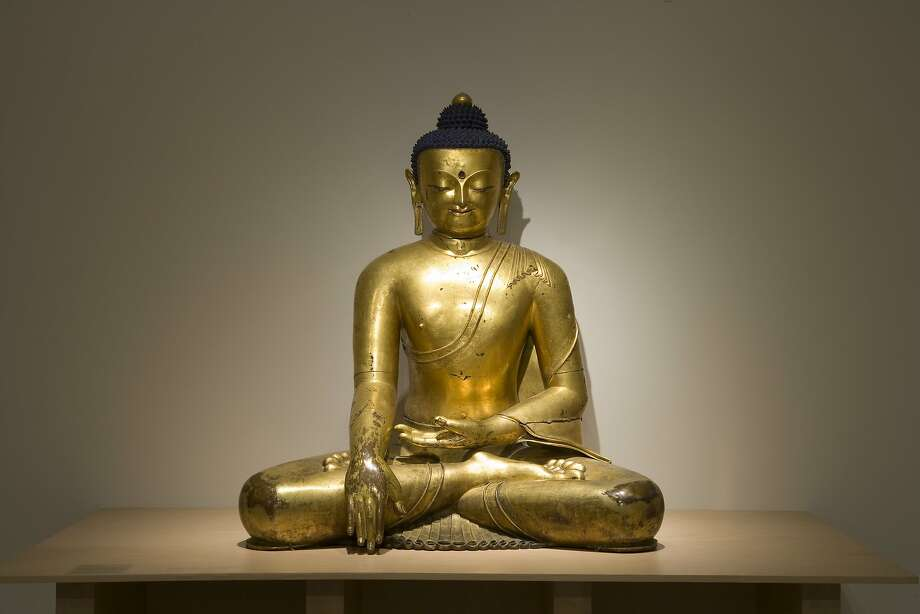 """A monumental gilt bronze� Buddha from 14th Tibet is on view in the exhibition """"Buddhist Art from the Roof of the World"""" at the Berkeley Art Museum. Courtesy BAMPFA. Photo: BAMPFA"""