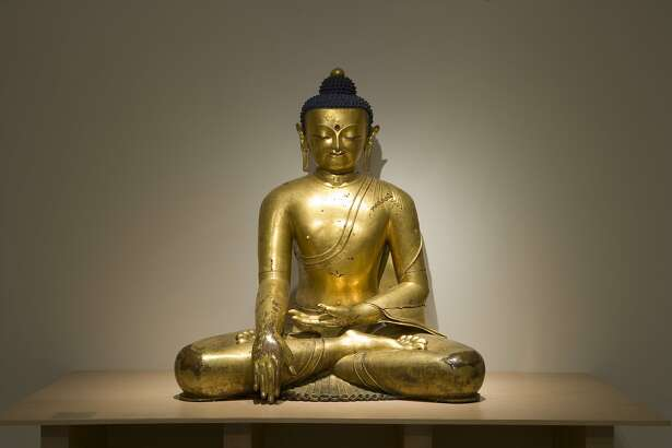 """A monumental gilt bronze� Buddha from 14th Tibet is on view in the exhibition """"Buddhist Art from the Roof of the World"""" at the Berkeley Art Museum. Courtesy BAMPFA."""