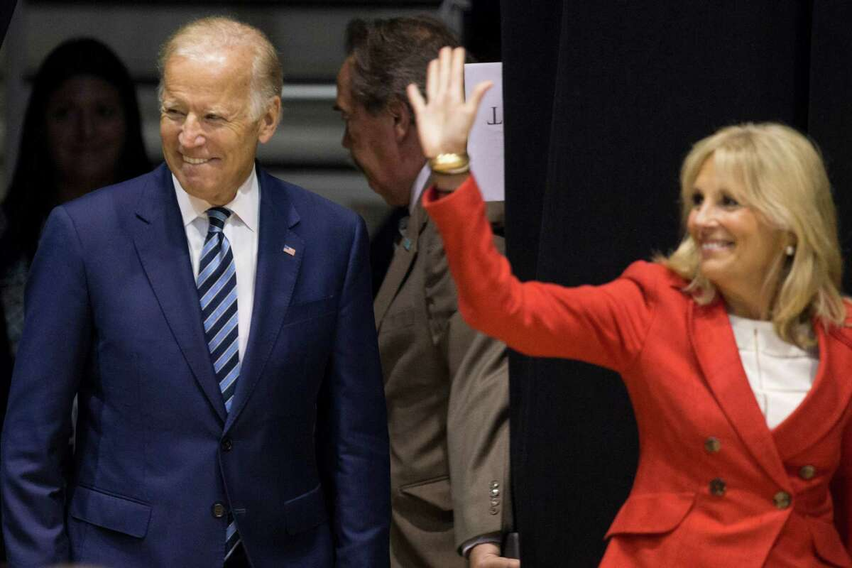 Vice President Joe Biden, left, and his wife, Dr. Jill Biden, arrive to Tudor Fieldhouse befrore the vice president's speech about the White House Cancer Moonshot, an initiative Biden leads, on the campus of Rice University on Friday, Sept. 16, 2016, in Houston.